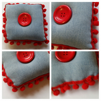 Pin cushion in upcycled denim with red bobble trim.