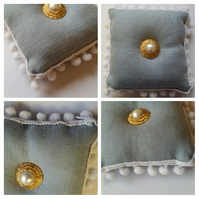 Pin cushion in blue with white bobble trim.