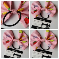 Hair bobble bow band in pink fruit salad fabric.