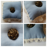 Pin cushion in blue with rose button.