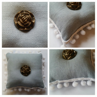 Pin cushion in blue with white bobble trim and rose button