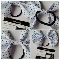 Hair bobble bow in white and blue polkadot fabric.