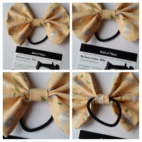 Hair bobble bow band in yellow floral fabric.