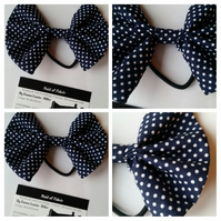 Hair bobble bow band in navy polkadot fabric.