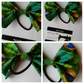 Hair bobble bow band in peacock fabric.