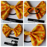 Hair bobble bow band in yellow patterned fabric.