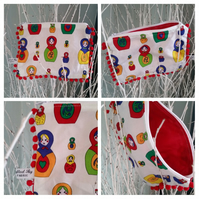 Pencil case in dolly fabric with red bobble trim.