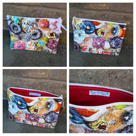 Makeup bag in pvc cake print with red lining.