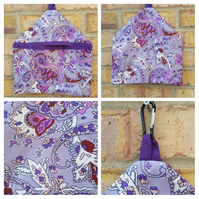 Peg bag in purple pattern fabric.