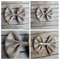 Hair bow slide clip in black and gold.