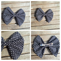 Hair bow slide clip in black and white polkadot.