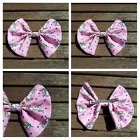 Hair bow slide clip in pink unicorns fabric.