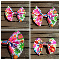 Hair bow slide in bright flower pattern.