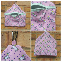 Peg bag in pink unicorn fabric with green lining.