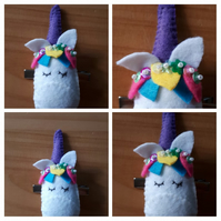 Unicorn hair slide clip with purple horn.