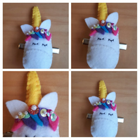 Unicorn hair slide clip with yellow horn.