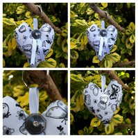 Heart keyring in white and black butterfly fabric.