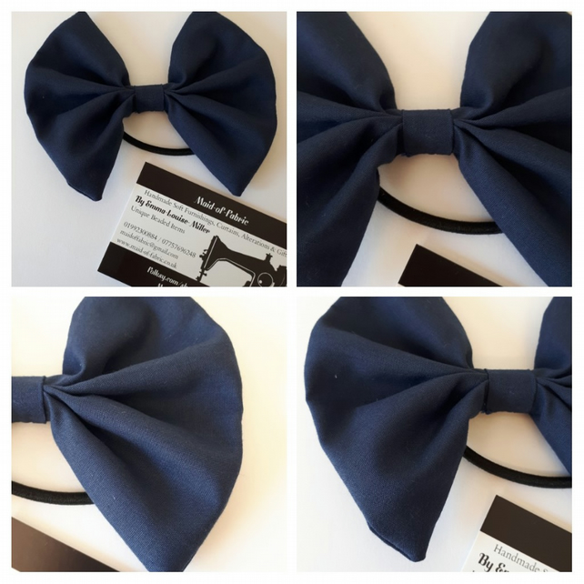 Hair bow bobble in navy fabric.