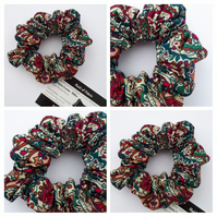 Scrunchie in cherry red pattern fabric.
