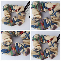 Scrunchie in cream and blue floral bird fabric.