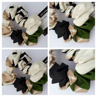 Hair scrunchie made using cream, green and black fabric. Free uk delivery.