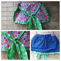 Denim apron pinny with green polkadot frills and flower power fabric.