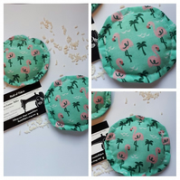 Heat pads  - hand warmers, rice filled in green flamingo fabric.