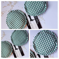 Hand warmers rice filled in green gingham fabric.