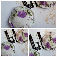 Hand warmers, heat pads rice filled in white floral fabric.