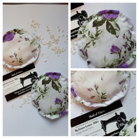 Hand warmers, heat pads rice filled in white and purple floral fabric.