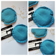 Heat pads, hand warmers, rice filled in blue polkadot fabric.