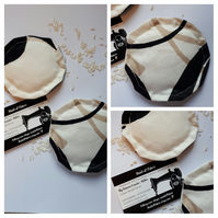Hand warmers rice filled in cream, black and tan fabric.