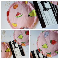 Hand warmers rice filled in pink fruit salad fabric.