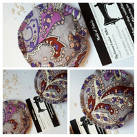 Hand warmers rice filled in purple patterned fabric.