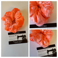 Hair scrunchie in neon coral crushed velvet.  Free uk delivery.