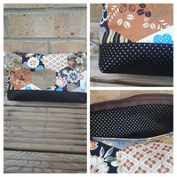 Makeup bag in brown tones fabric.