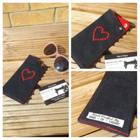 Glasses case in denim with red lining and heart beading.