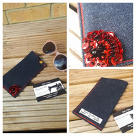 Glasses case in denim with red rose lining.