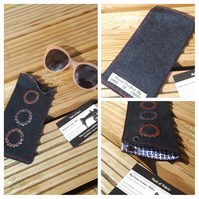 Glasses case in denim with white, blue and red circles lining.