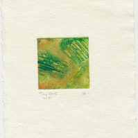 Tiny collagraph print in shades of green and ochre