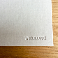 wedding planner in ivory lInen