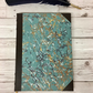 blue and marble and leather handbound ledger