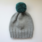 Bobble Hat in Light Grey Chunky Yarn with Petrol Green Pom Pom