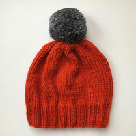 Bobble Hat in Burnt Orange Chunky Yarn with Grey Pom Pom