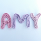 Three crochet applique letters (any 3 letters in a range of colours).