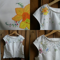 Handmade embroidered blouse made from vintage linens .