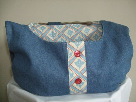 Across the shoulder peg bag