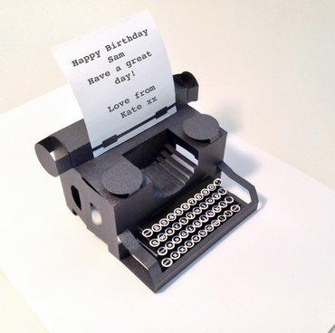 pop up typewriter card in black pearlescent paper with personalised message.