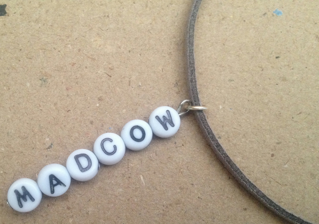 Letter pendant: mad cow