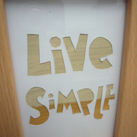 Handcut artwork: live simple